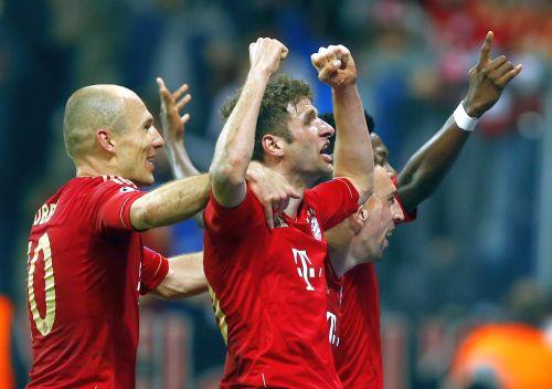 Bayern Munic players celebrate after scoring a goal