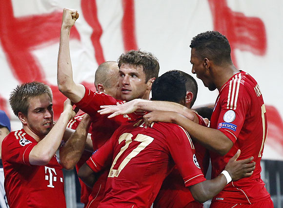 Bayern Munich's Thomas Mueller (centre) celebrates with teammates after scoring against Barcelona on Tuesday
