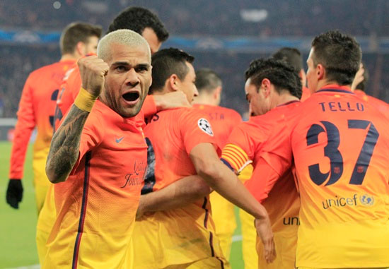 Barcelona's Daniel Alves (left) celebrates with teammates
