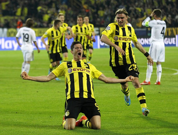 Borussia Dortmund's Robert Lewandowski celebrates with his teammate Marcel Schmelzer (right)