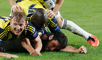 Fenerbache's players celebrate a goal on Thursday