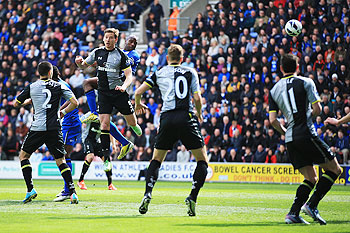 Emmerson Boyce (3rd left) of Wigan Athletic rises to head a goal against Spurs on Saturday