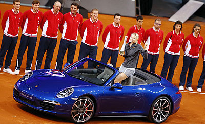 Russia's top seed and holder Maria Sharapova celebrates after she won a Porsche 911 4S in the final of the Stuttgart tennis Grand Prix following her victory against China's Li Na, on Sunday