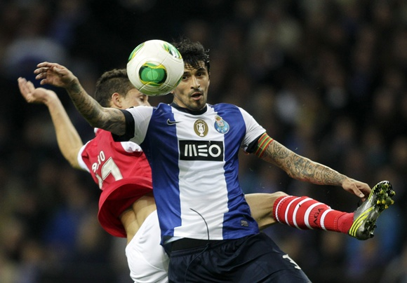 Porto's Lucho Gonzalez (right) battles for the ball