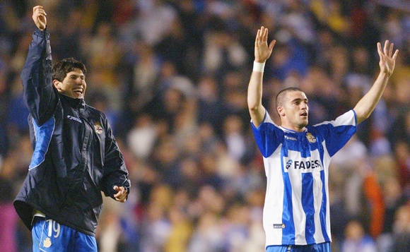 Alberto Luque and Walter Pandiani of Deportivo celebrate