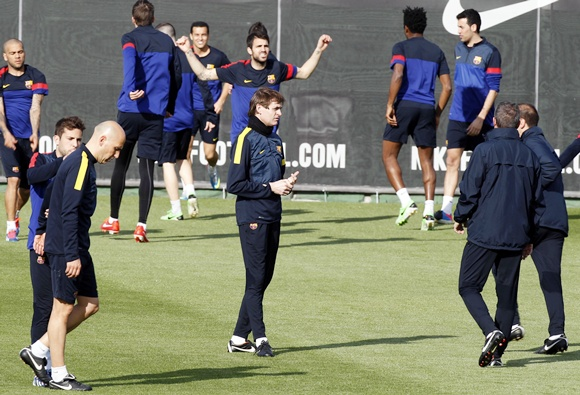 Barcelona's coach Tito Vilanova (centre) is surrounded by his players