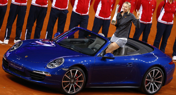 Russia's top seed and holder Maria Sharapova celebrates after she won a Porsche 911 4S in the final of the Stuttgart Grand Prix against China's Li Na