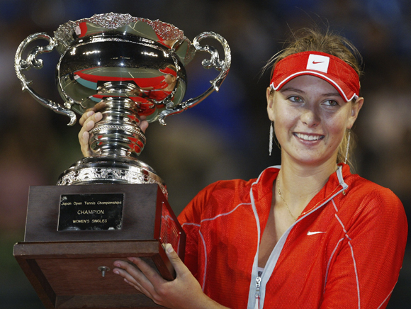 Maria Sharapova holds the trophy aloft after winning the final against Mashona Washington at the Japan Open in 2004