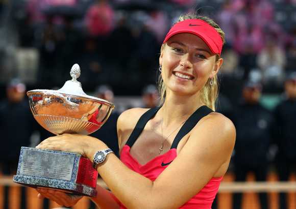Maria Sharapova of Russia celebrates with the trophy after defeating Na Li of China in the  final of the Internazionali BNL d'Italia 2012 in Rome