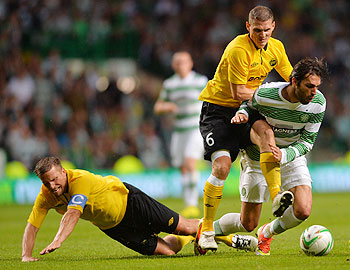 Georgios Samaras of Celtic takes on Anders Svensson and Jon Jonsson of Elfsborg during their UEFA Champions League third qualifying round first leg match at Celtic Park Stadium in Glasgow, Scotland, on Wednesday