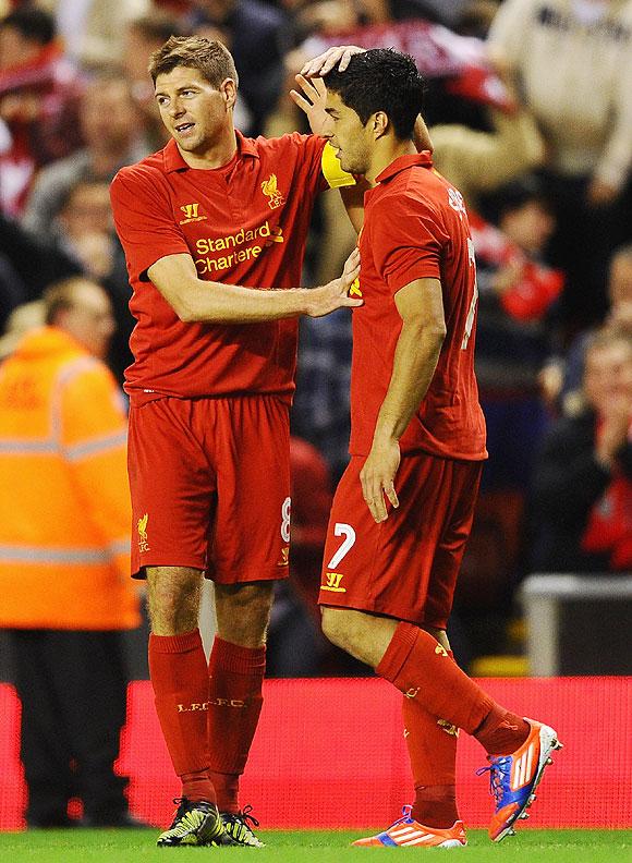Liverpool's Steven Gerrard and teammate Luis Suarez