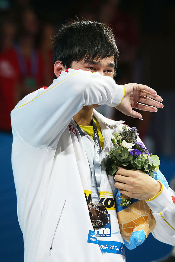 Yang Sun of China cries as he celebrates on the podium after winning the Swimming Men's 800m Freestyle final on Wednesday