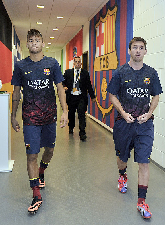 Lionel Messi and Neymar walk down the players tunnel during a Pre Season friendly between Lechia Gdansk and FC Barcelona on in Gdansk, Poland, on Tuesday