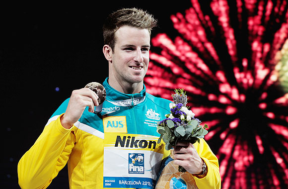 Gold medal winner James Magnussen of Australia celebrates on the podium on Thursday