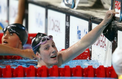 Missy Franklin of the U.S. (R) reacts next to compatriot Elizabeth Pelton after winning the women's 200m backstroke final
