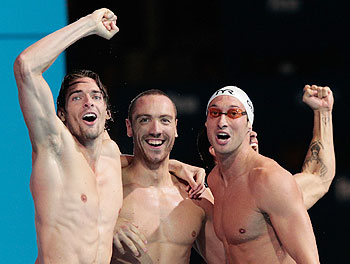Camille Lacourt, Fabien Gilot and Jeremy Stravius of France celebrate after the USA are disqualified and they were announced winners of the swimming men's medley 4x100m relay final on at the 15th FINA World Championships at Palau Sant Jordi in Barcelona, Spain, on Sunday