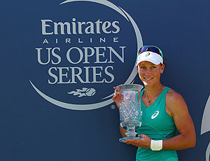 Samantha Stosur of Australia poses with the trophy after beating Victoria Azarenka of Belarus at the Southern California Open in Carlsbad, California on Sunday