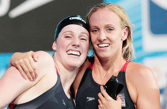 Missy Franklin of the USA celebrates with teammate Dana Vollmer after the Swimming Women's Medley 4x100m Relay final in Barcelona on Sunday