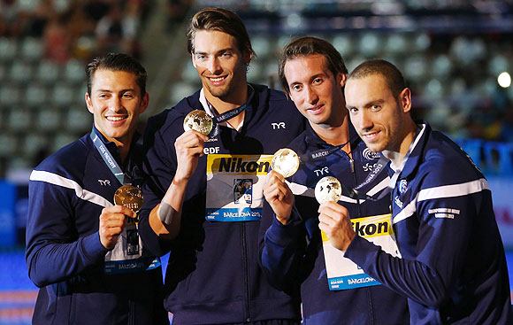 Gold medal winners Giacomo Perez-Dortona, Camille Lacourt, Fabien Gilot and Jeremy Stravius of France celebrate on the podium after the Swimming Men's Medley 4x100m Relay final in Barcelona on Sunday