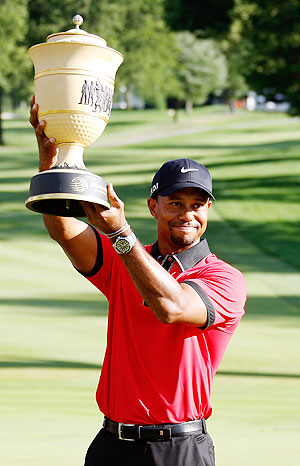 Tiger Woods holds up the Gary Player Cup trophy after the Final Round of the World Golf Championships-Bridgestone Invitational at Firestone Country Club South Course in Akron, Ohio. on Sunday