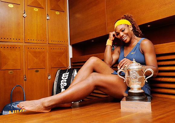 Serena Williams poses with the Coupe Suzanne Lenglen trophy in her changing room on Saturday