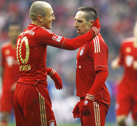 Franck Ribery of Bayern Munich with teammate Arjen Robben (left)