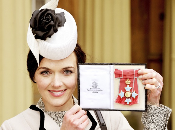 Olympic cyclist Victoria Pendleton holds her Commander of the British Empire (CBE) award at Buckingham Palace