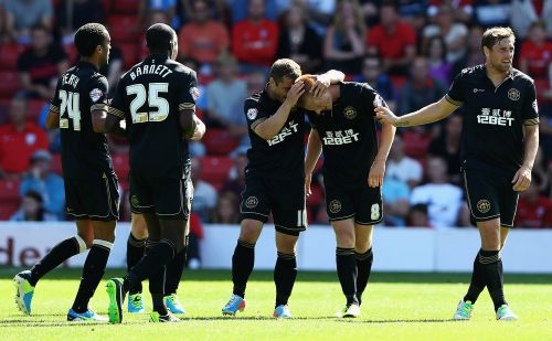 Wigan players celebrate after a goal