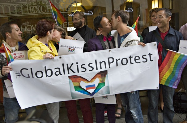 Protesters kiss outside the Russian Consulate in Vancouver