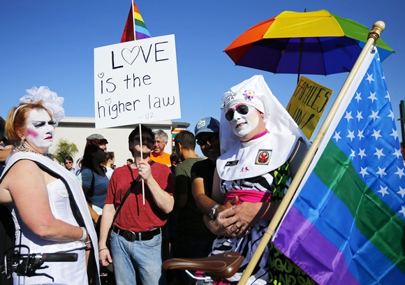 People dress up as they attend   a rally in support of the United States Supreme Court decision on marriage rights in San Diego