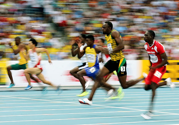 PHOTOS: No frills or fanfare as Bolt eases into his stride at worlds