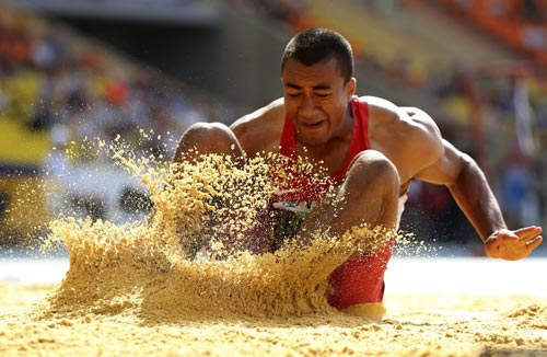 Ashton Eaton of the U.S. competes in the men's decathlon long jump event at the IAAF World Athletics Championships