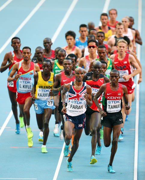 Mo Farah of Great Britain (left) and Paul Kipngetich Tanui of Kenya lead the men's 10,000m final