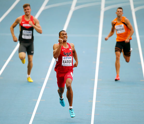 Ashton Eaton (centre) of the United States competes in the men's decathlon 400 metres