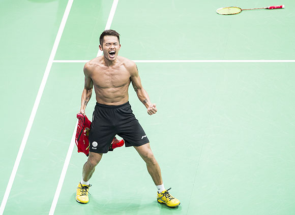 Lin Dan of China celebrates after winning the men's singles final match against Lee Chong Wei of Malaysia at the Tianhe Gymnasium in Guangzhou, on Sunday
