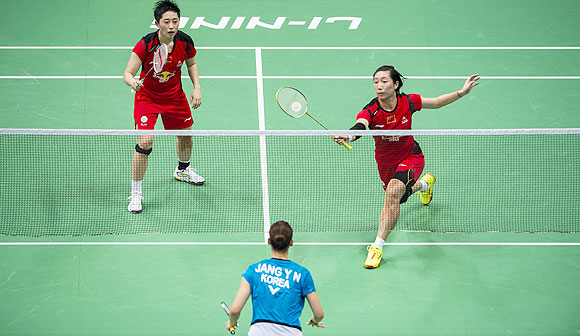 Wang Xiaoli and Yu Yang of China in action during their women's doubles final against Eom Hye Won and Jang Ye Na of South Korea at the Tianhe Gymnasium in Guangzhou, on Sunday
