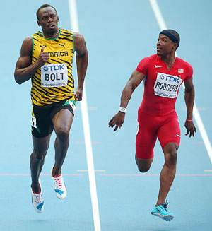 Usain Bolt of Jamaica and Mike Rodgers of the United States compete in the Men's 100 metres semi-final on Day Two of the 14th IAAF World Athletics Championships at Luzhniki Stadium in Moscow, on Sunday