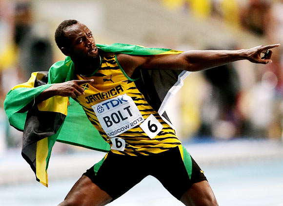 Usain Bolt celebrates after winning the men's 100m