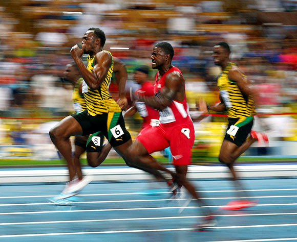 Usain Bolt (left) takes the lead in the men's 100m