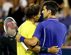 Rafael Nadal of Spain is congratulated by Novak Djokovic of Serbia after their match
