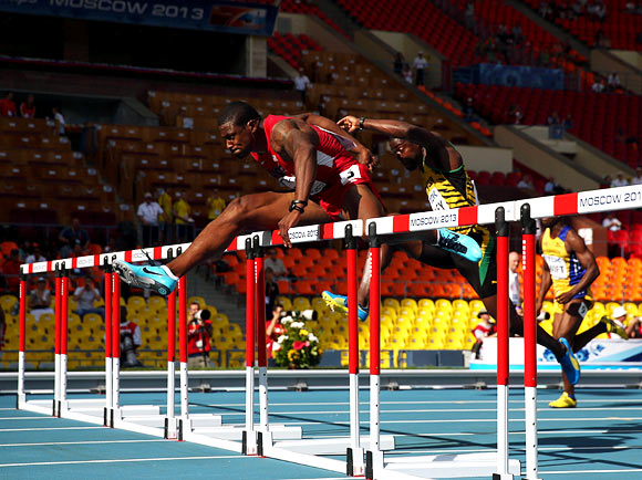 David Oliver leads in the men's 110 metres hurdles heats