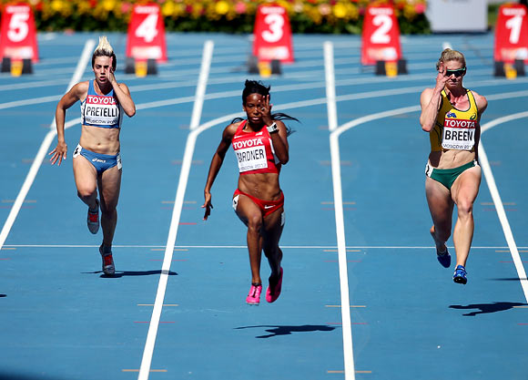 (Left to right): Martina Pretelli of San Marino, English Gardner of the United States and Melissa Breen of Australia compete in the Women's 100 metres heats