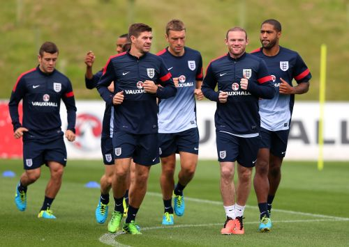 Wayne Rooney, Steven Gerrard and Rickie Lambert of England warm up during a training session at St Georges Park