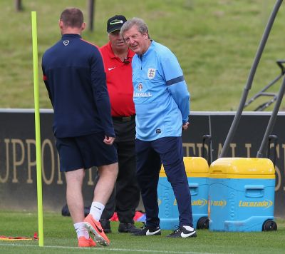 Roy Hodgson the manager of England keeps an eye on Wayne Rooney during a training session