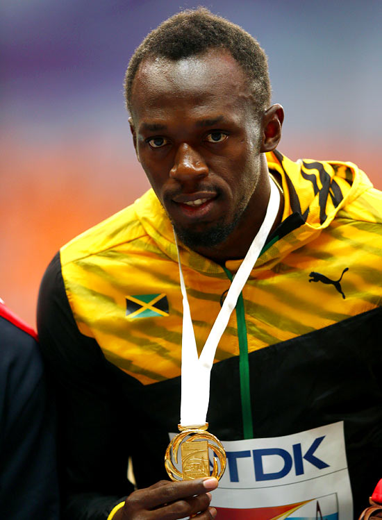 Gold medalist Usain Bolt on the podium during the medal ceremony for the men's 100 metres