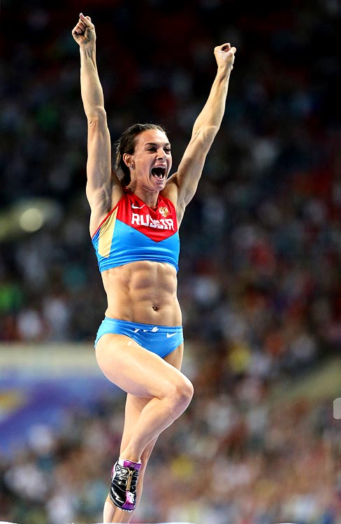 Yelena Isinbayeva celebrates after winning the gold medal in the women's pole vault