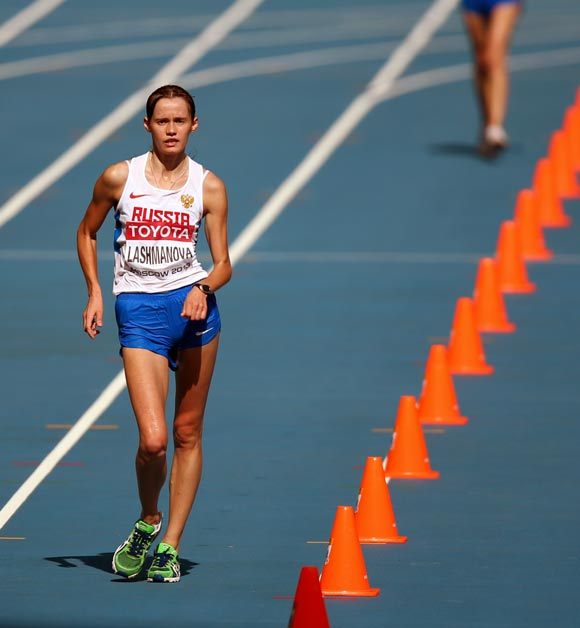 Elena Lashmanova of Russia heads towards the finish to win the gold in the women's 20-km race walk