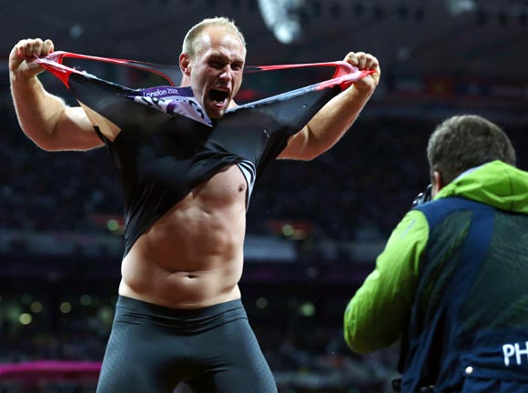 Robert Harting of Germany celebrates winning gold in the Men's Discus Throw final at the 2012 London Olympics
