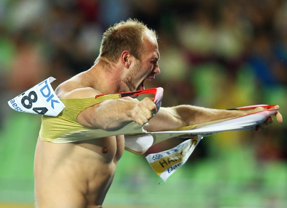 Robert Harting of Germany celebrates as he wins gold in the men's discus throw final at the 13th IAAF World Athletics Championships at Daegu Stadium in South Korea in August 2011