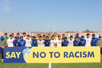 The India and Tajikistan team pose for a photograph before the matc